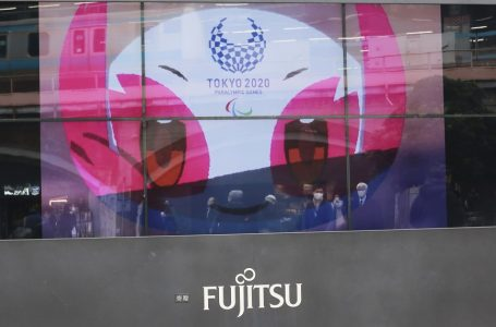 """FILE – In this Dec. 9, 2020, file photo, a TV monitor displays Tokyo 2020 Paralympic Games mascot Someity in Tokyo, Wednesday, Dec. 9, 2020.  Tokyo Olympic officials said Thursday, Dec. 24, they have reached a """"basic agreement"""" with all 68 domestic sponsors to extend their contracts into next year to support the postponed Games.  (AP Photo/Koji Sasahara, File)"""